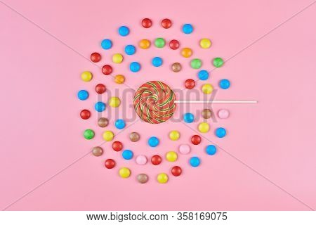 Sweet Lollipop And Candy On Pink Background, Copy Space. Love To Colorful Sweetmeats In Childhood Co