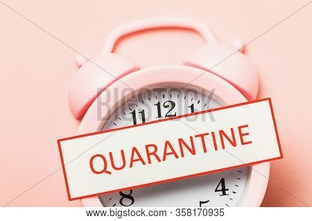 Tag With Text And Alarm Clock, Top View. Quarantine Duration Concept