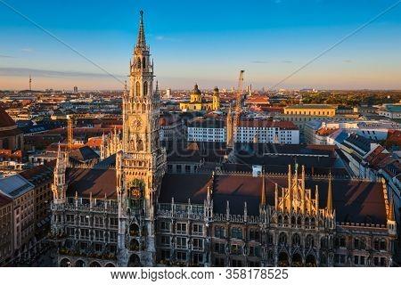 View of Munich: Marienplatz, Neues Rathaus from St. Peter's church on sunset. Munich, Germany
