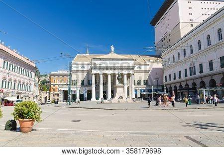 Genoa, Italy, September 11, 2018: Teatro Carlo Felice Theatre Building And Monumento A Garibaldi Mon