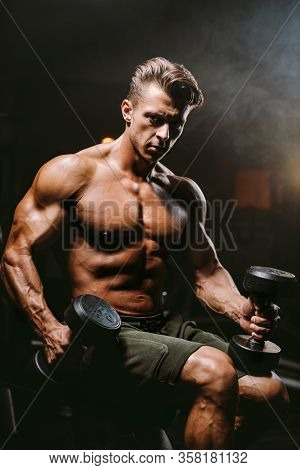 Handsome Fitness Model Workout In Gym Gain Muscles