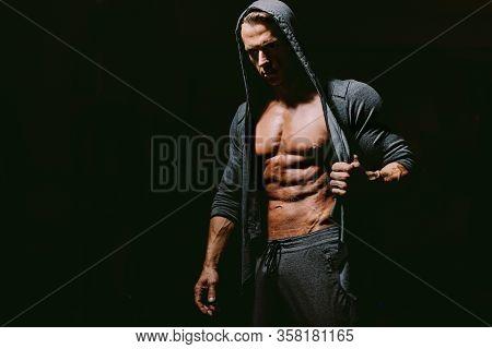 Brutal Man Wearing Hoodie On Naked Body.