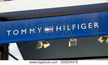 Palma de Mallorca, Spain - September 23, 2017.  Tommy Hilfiger store sign. Tommy Hilfiger is an American premium clothing company, manufacturing apparel, footwear and accessories.