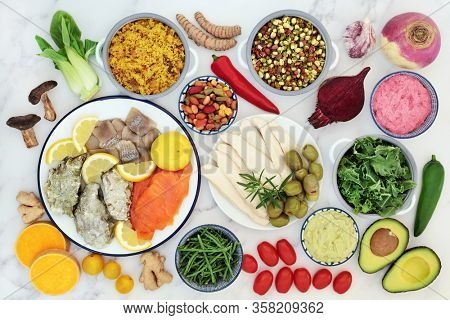 Super food to boost the immune system for a healthy life  with health foods high in antioxidants, anthocyanins, vitamins, minerals, protein, smart carbs, omega 3 and fibre. Flat lay on marble.