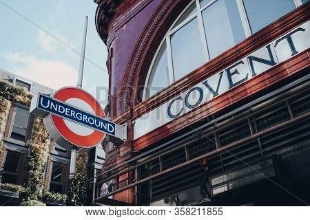 London, Uk - March 06, 2020: Underground Roundel And Station Name Sign Outside Covent Garden Station