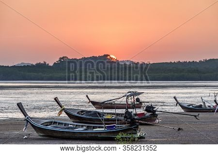 Long-tail Boats At Low Tide At Sunset On Ko Yao Noi Island Near Phuket In Southern Thailand