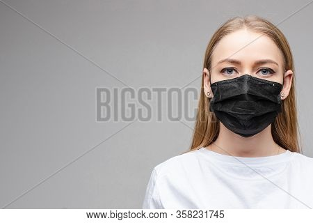 Woman In Black Aseptic Respirator. Corona Virus Protection Concept.
