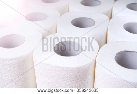 Toilet Paper Supplies Background. Wc Paper Rolls Top View. Goods Required For Quarantine.