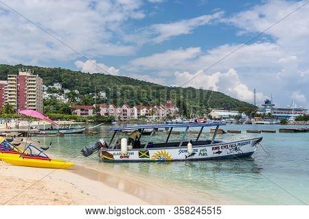 Ocho Rios, Jamaica - April 22, 2019: Snorkeling Motor Boat Moored On The Ocho Rios Bay Beach In Ocho