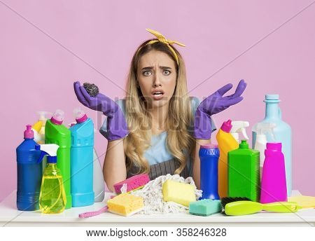 Keep House Clean Concept. Housewife Spreads Hands With Cleaning Supplies, Free Space
