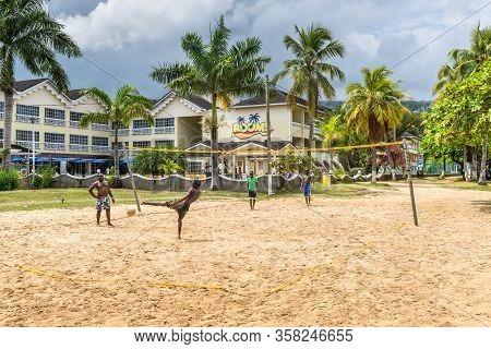 Ocho Rios, Jamaica - April 22, 2019: Jamaican Guys Playing Volleyball At The Ocho Rios Bay Beach In