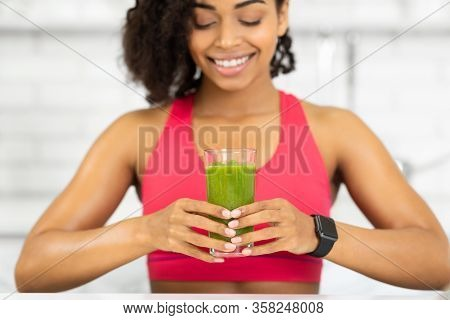 Healthy Drink. Smiling Black Girl Holding Glass With Delicious Detox Smoothie, Close Up