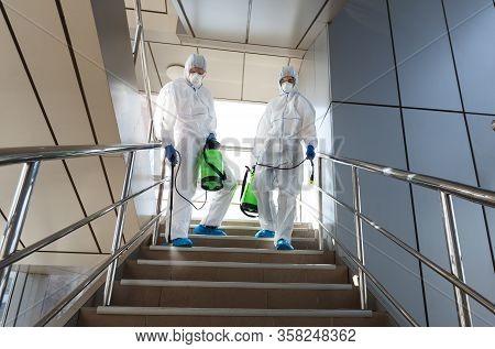 Covid-19, Coronavirus, Men In Virus Protective Suits Carrying Barrels, Pathogen Respiratory Quaranti