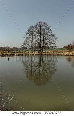 Sunny Spring Day In The Countryside. Water Reflection. Trees Reflected In Water. Tranquil Landscape