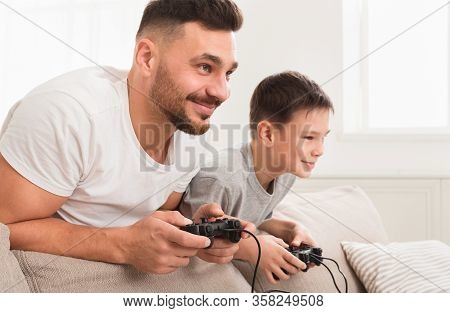 Self-isolated Dad And Son Playing Video Games At Home During Quarantine, Free Space