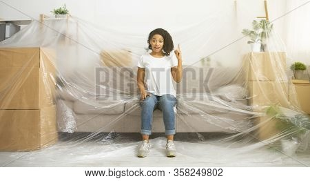 Funny African American Girl Sit On Couch Covered Polyethylene, Panorama