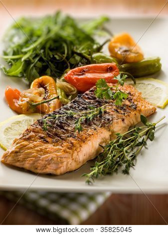 grilled salmon with capsicum and arugula, selective focus