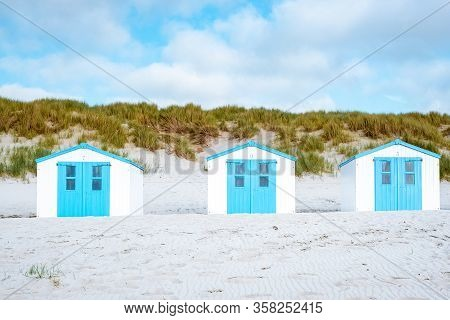 Texel Island Netherlands, Blue White Beach Hut On The Beach With On The Background The Sand Dunes Of
