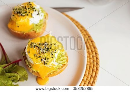 Aavocado Toast With Poached Egg With And Hollandaise Sauce