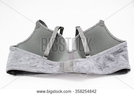 Simple Grey Bra On A White Background. Wrong Side, Wrong Side Of Underwear , Hook-and-eye Closure