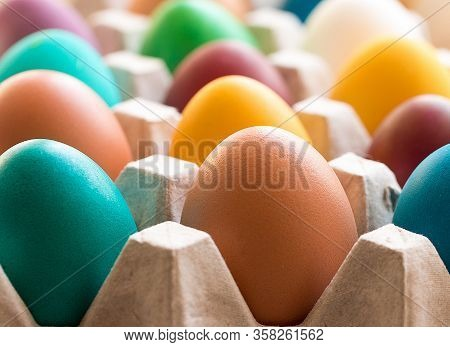 Different Colorful Easter Eggs In The Cardboard Egg Tray. Easter Decoration. Selective Focus. Macro.