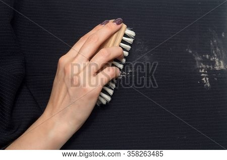 Dry Cleaning: A Woman Hand With Holding A Clothes Brush For Cleaning Clothes From Dirty