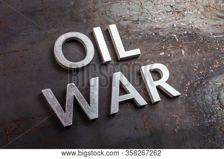 Words Oil War Laid With Silver Metal Letters On Rusted Heavy Hot Rolled Uncoated Steel Sheet Surface