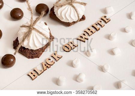 Chocolate Day July 7th.sweets On White Background, A Steak Of White And Black Chocolate. Concept Of