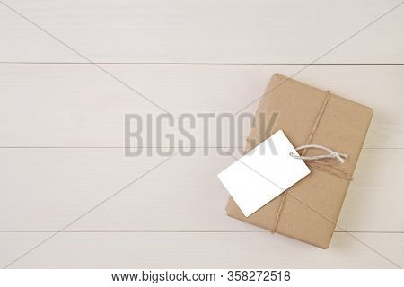 Gift Box And Tag On Wooden Background With Romantic, Presents For Mother Day Or Valentine Day With P