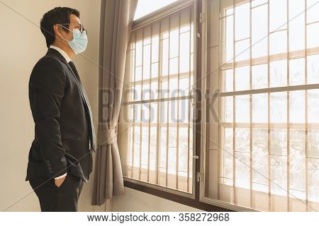 Social Distancing Businessman Wearing Protective Mask Preventing Covid - 19 Standing In The House