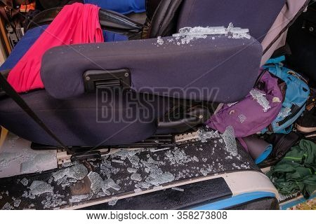 Smashed Passenger Window Of A Camper Van, Goods Stolen And Interior Vandalized, Burglary And Robbery