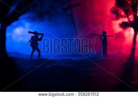 War Concept. Military Silhouettes Fighting Scene On War Fog Sky Background,