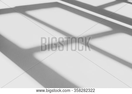 Abstract Shadow Of The Window In Morning Light On White Wall Texture Background