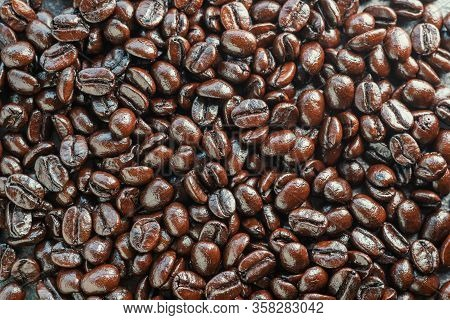 Close Up Of Dark Roast Arabica Coffee Beans Background