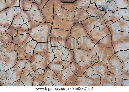Dry Soil Ground Cracks Background Texture In Drought, Top View