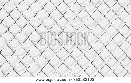 Wire Mesh And Shadow On White Wall Background