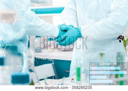 Closeup Scientists Handshake In Medical Gloves In Laboratory. Pharmacists Virologists Invented Vacci