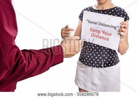 Person Pointing Placard With Social Distancing, Keep Your Distance Warning.  Prevent Coronavirus Cov