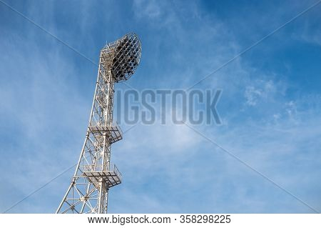 The Floodlights At The Stadium, Afternoon, Blue Sky Background.