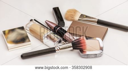 Cosmetics For Daily Makeup On The Table. Mascara, Tone, Lipstick, Eye Shadow, Makeup Brushes, Powder