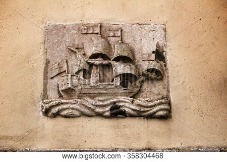 Lisbon, Portugal- March 4, 2020: Old Galleon Image Carved On Stone On A Lisbon Facade