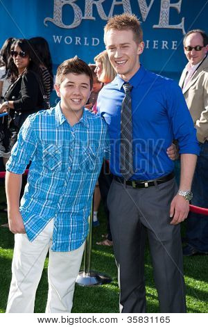 HOLLYWOOD, CA - JUNE 18: Bradley Steven Perry and Jason Dolley arrive at the Los Angeles Film Festival premiere of 'Brave' at Dolby Theatre on June 18, 2012 in Hollywood, California.