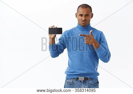 Internet, Online Lifestyle And People Concept. Portrait Of Angry, Hateful Young African-american Man