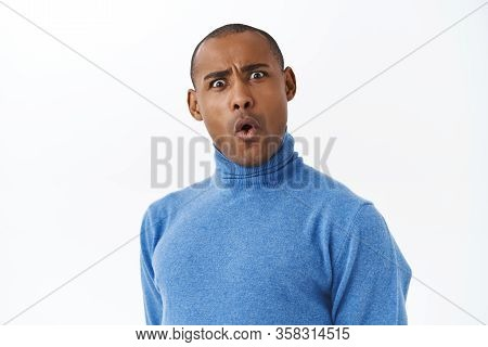 You Say What. Close-up Portrait Of Funny Startled And Shocked African American Adult Guy, Folding Li