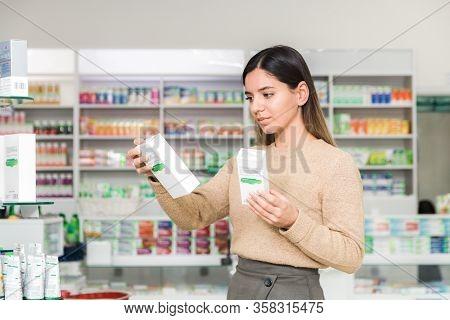 Woman Choosing Vitamins And Supplements For Immune System. Coronavirus Pandemic Necessity