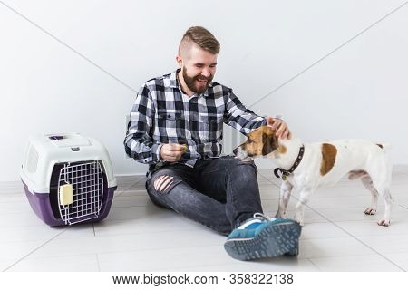 Dog Carrying Bags And Pets Owner Concept - Attractive Cheerful Male In Plaid Shirt Holds Favourite P