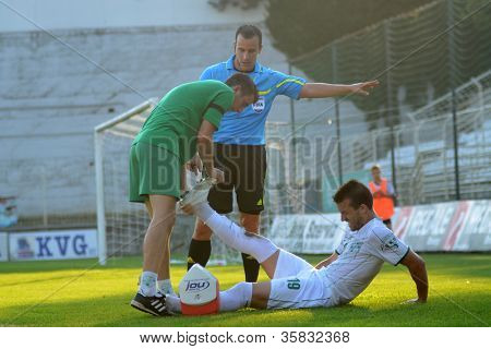 KAPOSVAR, HUNGARY - AUGUST 4: Bojan Vrucina (white 19) injured at a Hungarian National Championship soccer game Kaposvar (white) vs Debrecen (red) August 4, 2012 in Kaposvar, Hungary.