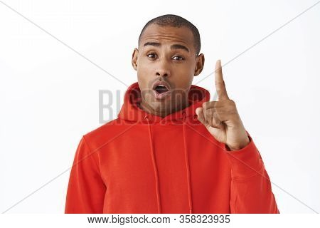Guy Have Suggestion. African-american Handsome Man In Red Hoodie, Raising Finger Have Something Say,