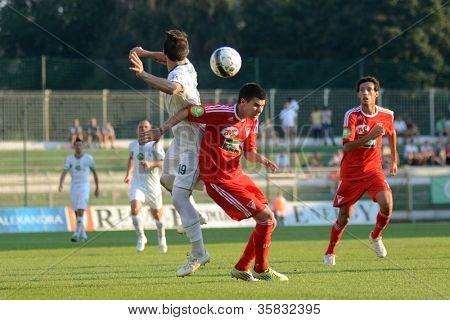 KAPOSVAR, HUNGARY - AUGUST 4: Unidentified players in action at a Hungarian National Championship soccer game Kaposvar (white) vs Debrecen (red) on August 4, 2012 in Kaposvar, Hungary.