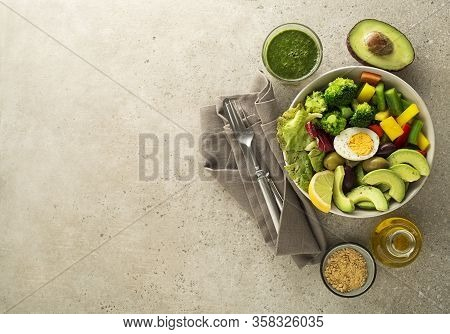 Healthy Salad Meal With Egg, Avocado And Mixed Fresh Vegetables On Grey Background Top View. Food An